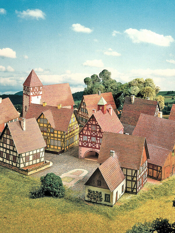 Cut-out-sheets village with half-timbered houses