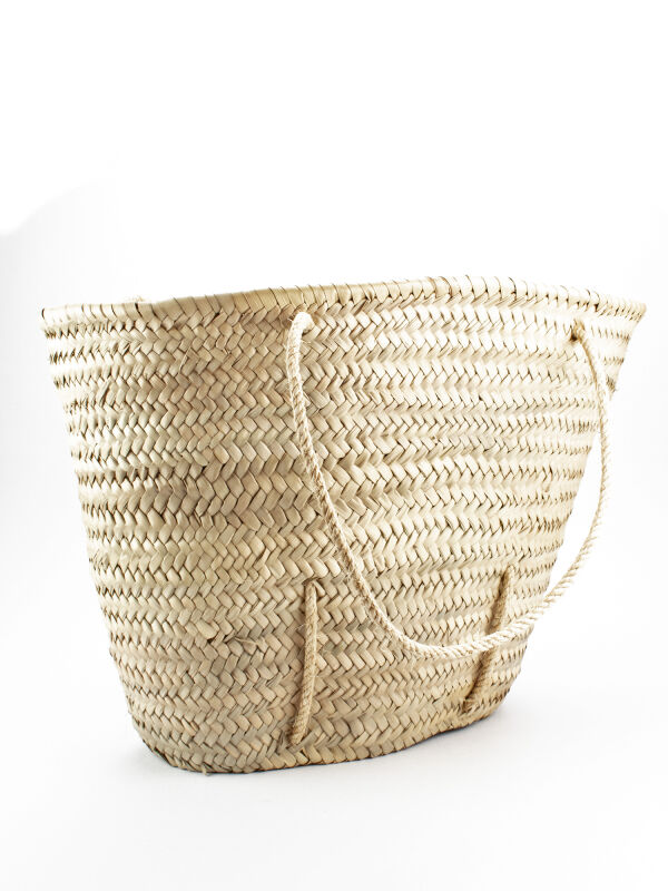 Carrying basket made of palm fronds by Bar Kochba